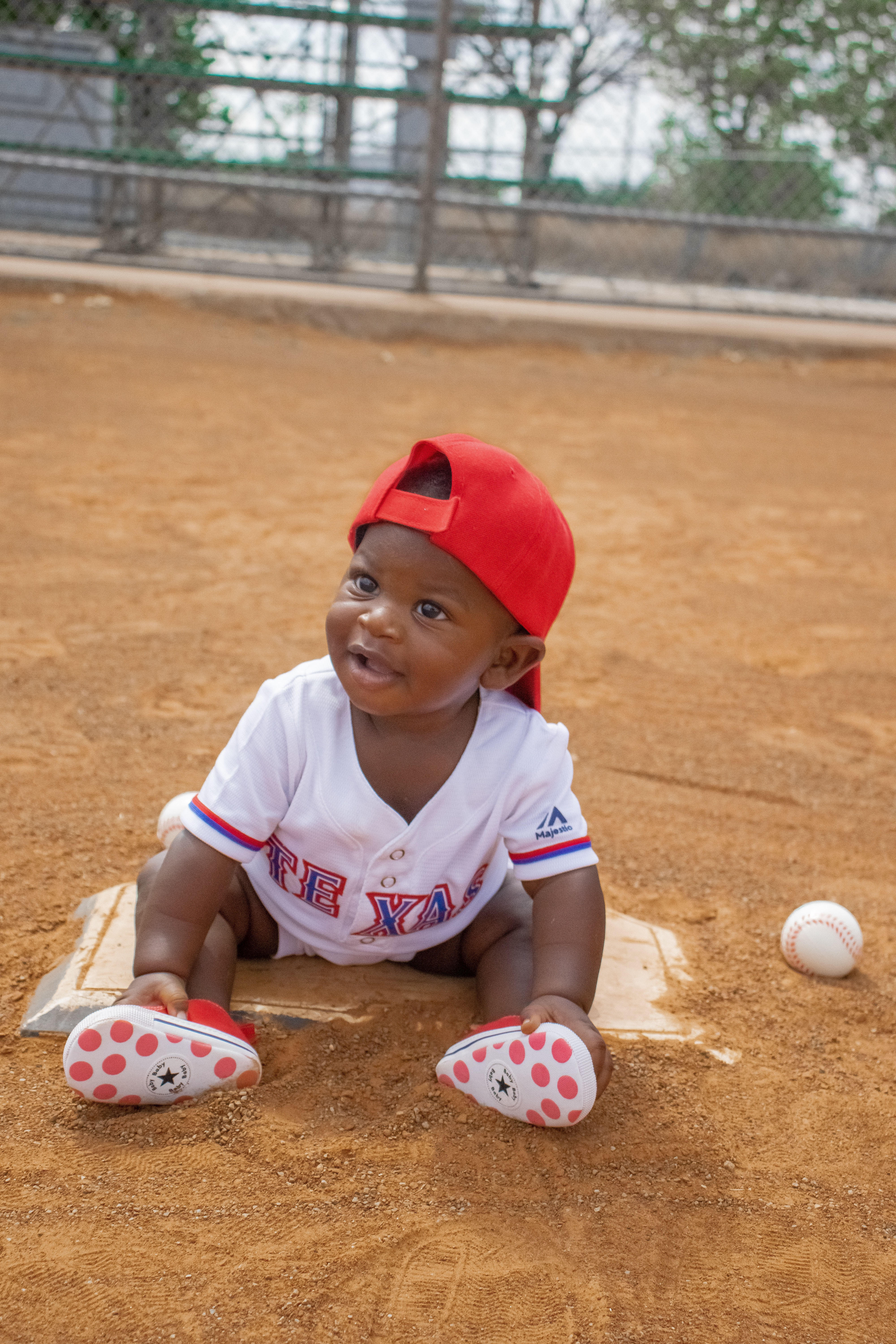 Baby boy in Texas Rangers Jersey  and red hat