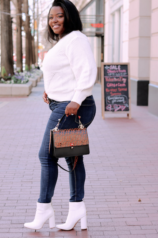 Walking in downtown with statement bag and cream cardigan