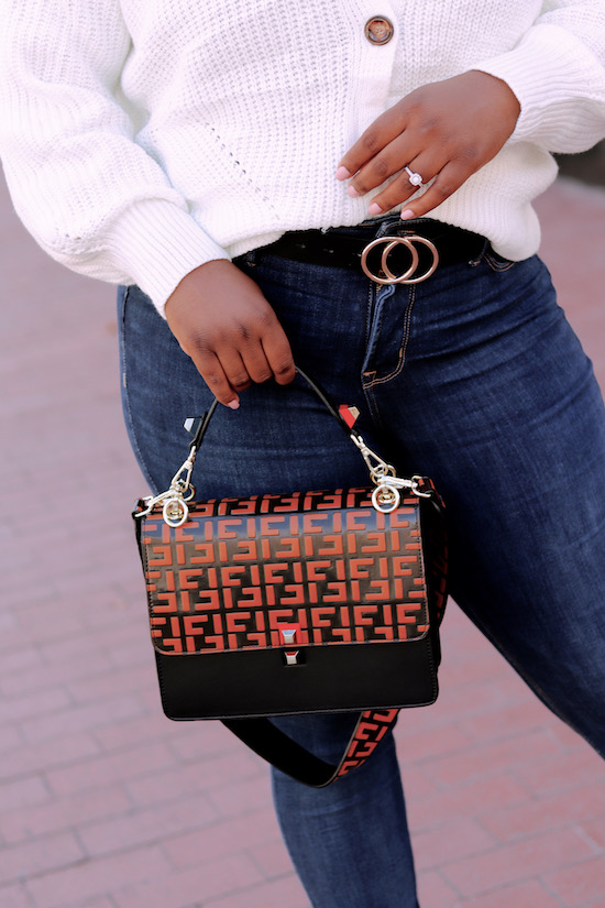 Statement bag with high wasted jeans and belt