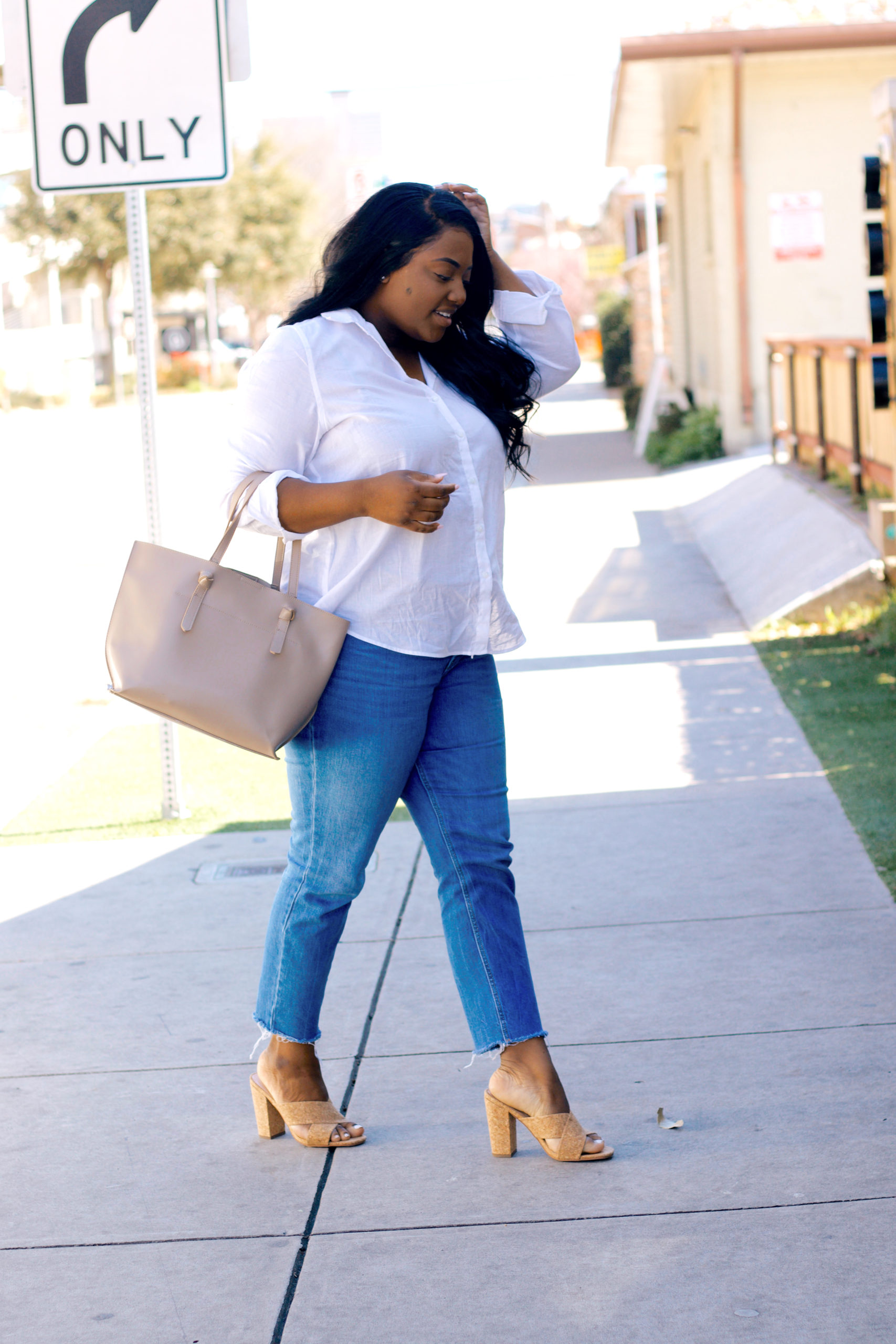 go-to Spring outfit with white button downs and jeans and tan cork sandals