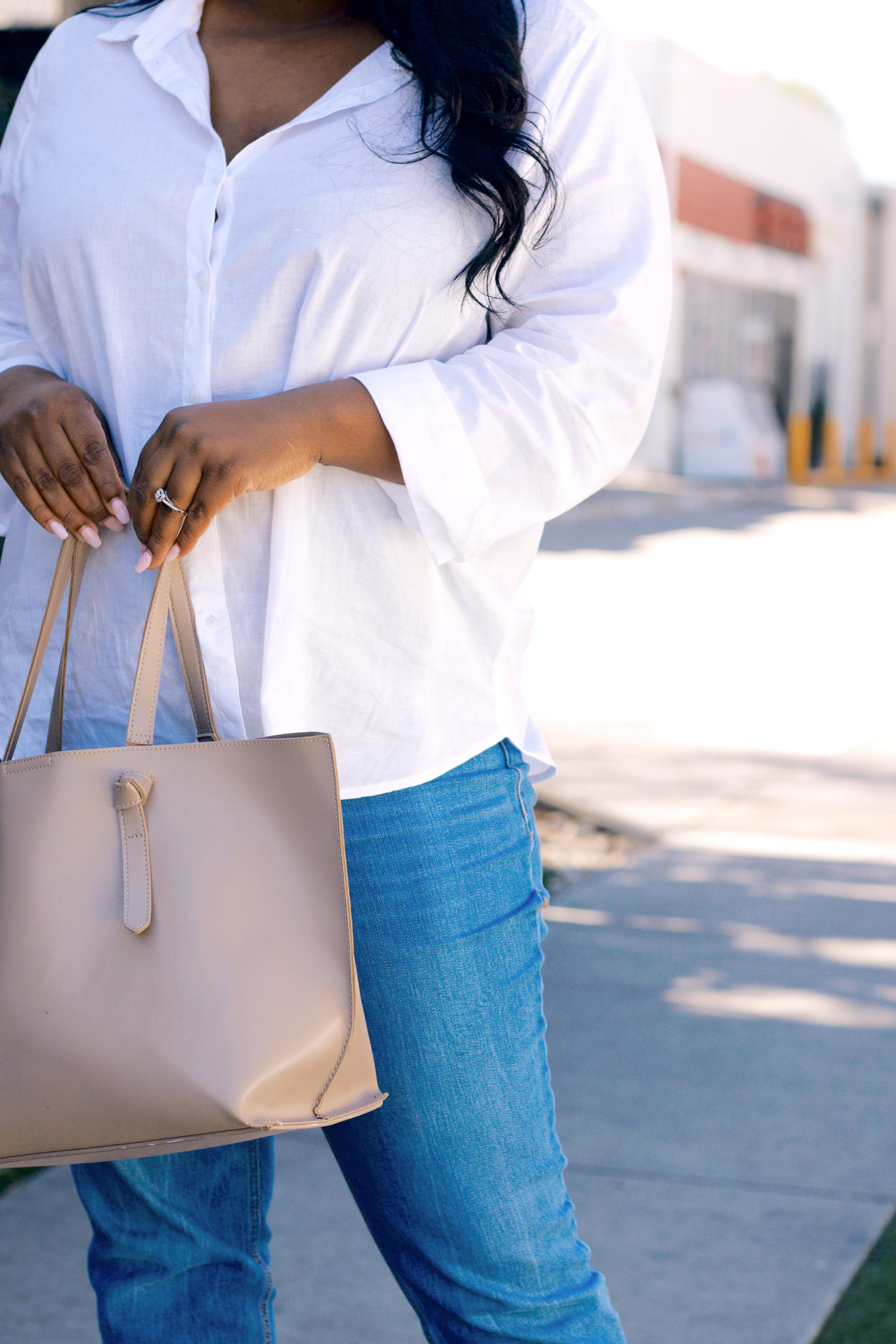 go-to Spring outfit with white button downs and jeans and tan bag
