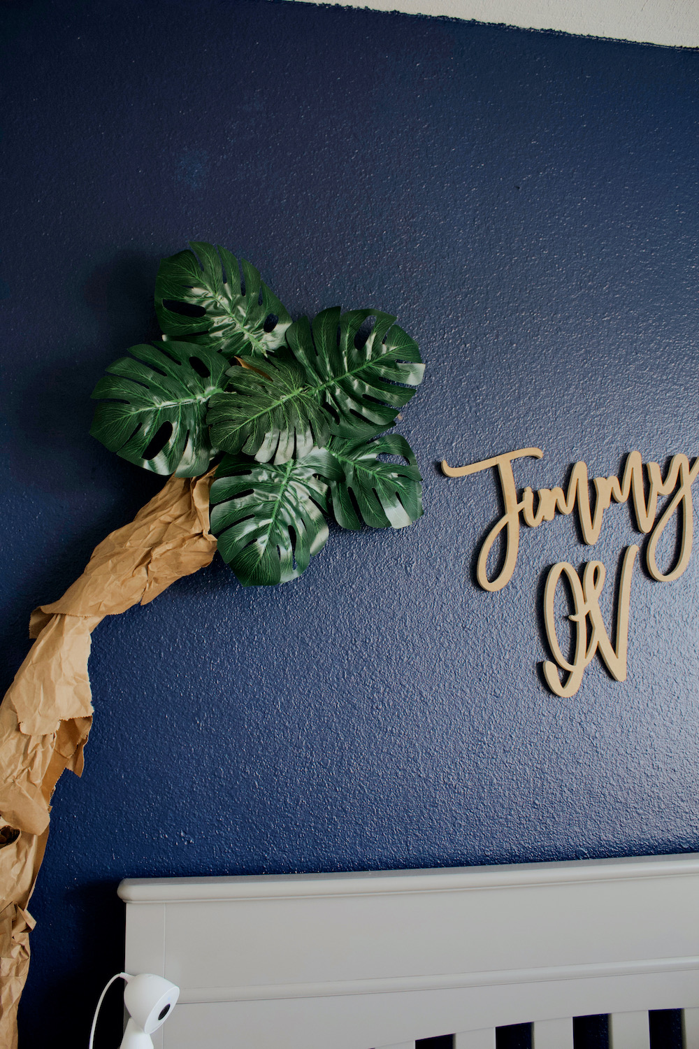 navy blue accent wall baby boys nursery