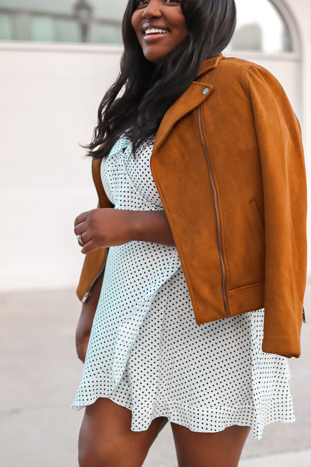 moto jacket and polka dot dress